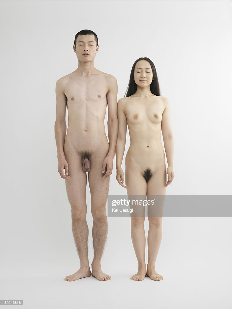 guy standing by naked girl